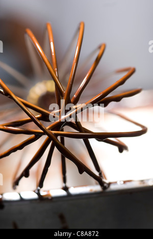 Whisk coated with melted chocolate - Stock Photo