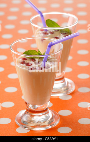 Cream of banana soup with pomegranate seeds - Stock Photo