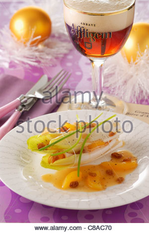 Stuffed turkey Supreme with dried fruit and wrapped in braised chicory with beer - Stock Photo