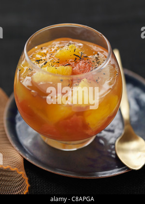 Citrus fruit in tea-flavored jelly - Stock Photo