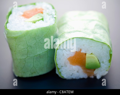 Salmon and avocado lettuce makis - Stock Photo