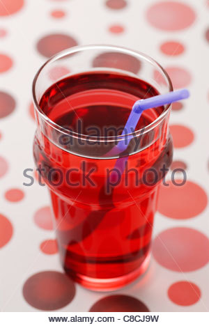 Glass of pomegranate syrup - Stock Photo