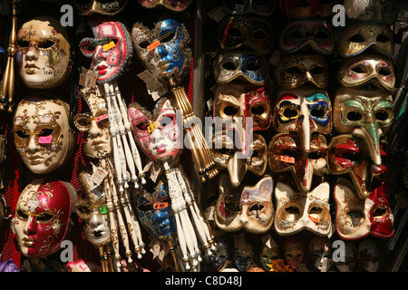 Traditional Venetian masks in a souvenir shop in Venice, Italy. - Stock Photo