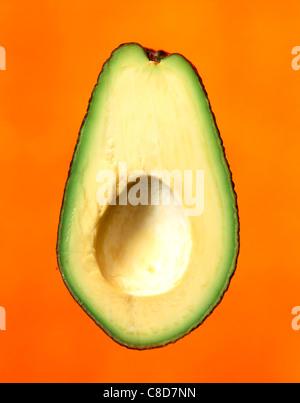 Avocado half without stone - Stock Photo