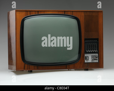 vintage black and white tv on gray background, side view - Stockfoto
