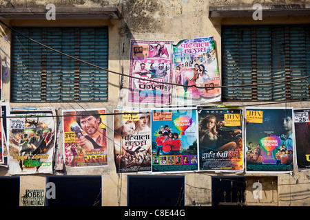Indian movie posters, Bollywood, in the city of Varanasi, Benares, Northern India - Stock Photo