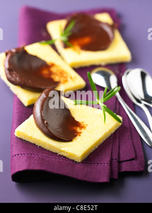 Shortbread cookies with chocolate Ganache and rosemary - Stock Photo