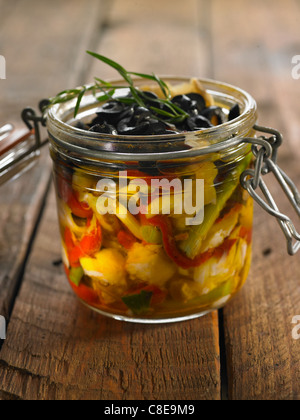 Cod,red pepper,black olive and rosemary in olive oil - Stock Photo
