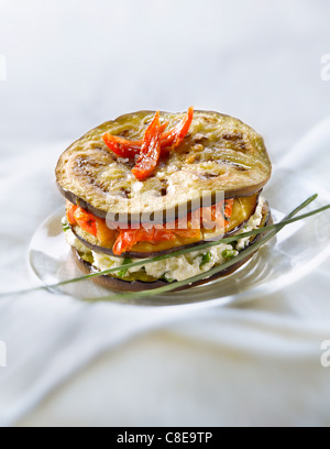 Eggplant,goat's cheese with chives and dried tomato Mille-feuille - Stock Photo