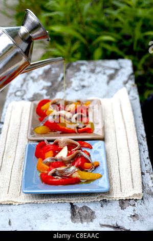 Red and yellow pepper and anchovy salad - Stock Photo