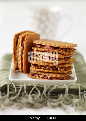 Homemade Spéculos and chocolate sandwich biscuits - Stock Photo