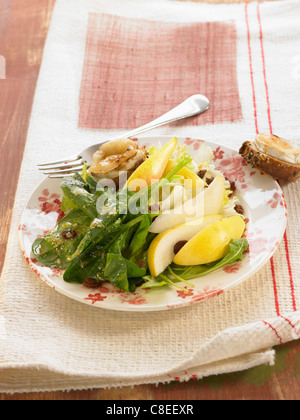 Lamb's lettuce,pear and goat's cheese salad - Stock Photo