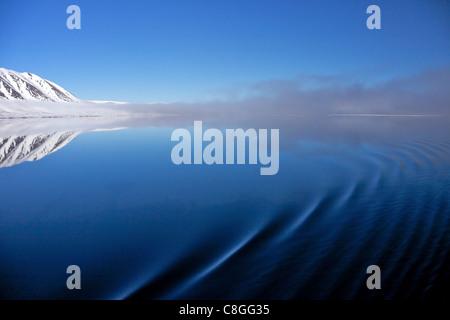 Ripples on sea in summer, Liefdefjorden, Spitzbergen, Svalbard, Arctic Norway, Scandinavia - Stock Photo