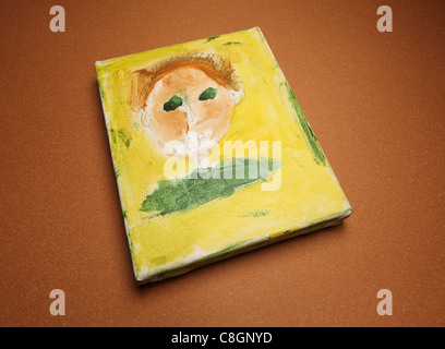 A child's handmade self portrait painting. - Stock Photo