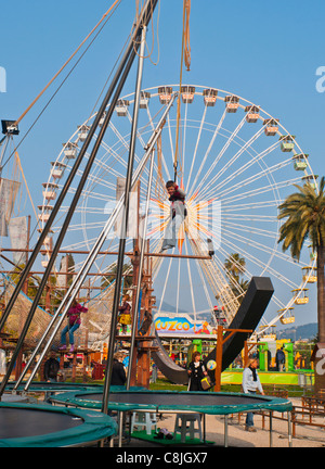 nice-france-children-enjoying-annual-events-carnival-rides-on-street-c8jgx7.jpg