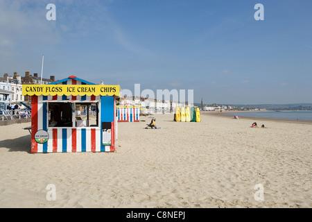 Great Britain, England, Dorset, Weymouth, Beach with ice cream stall - Stock Photo