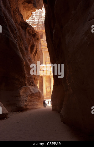 The Treasury (al khazneh) viewed from the narrow Siq at the Ancient city of Petra, Jordan - Stock Photo