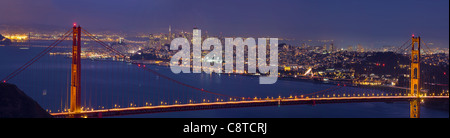 Golden Gate Bridge Over San Francisco Bay and Skyline at Dusk Panorama - Stock Photo
