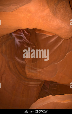 Antelope Canyon is formed from Navajo Sandstone eroded by flash floods and rainwater. This has created holes and - Stock Photo