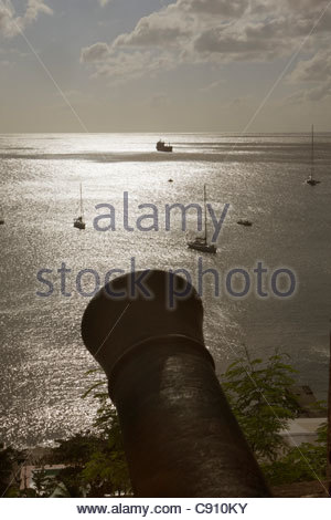 The Netherlands, Oranjestad, Sint Eustatius Island, Dutch Caribbean. Oranjestad Bay from fort. Cannon - Stock Photo