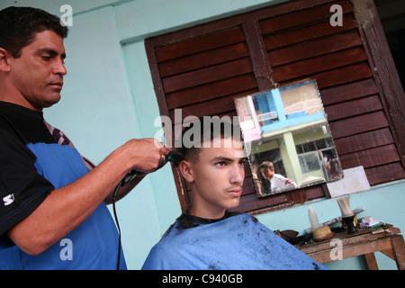 Street barber in Pinar del Rio, Cuba. - Stock Photo