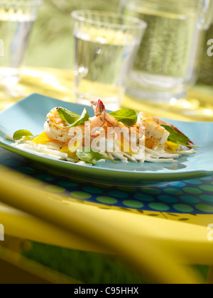 Shrimp salad served with water in an outdoor setting - Stock Photo