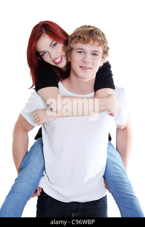 Portrait of a handsome young man giving a piggyback ride to his girlfriend over white background. - Stock Photo