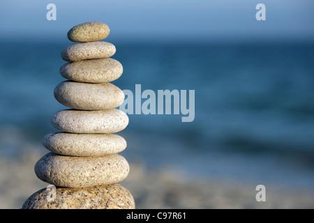 Stone balance pebble stones on beach - Stock Photo