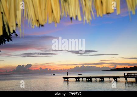 Curaçao Netherlands Antilles Dutch Piscadera Bay Caribbean Sea pier man standing boat coastline sunset twilight - Stockfoto
