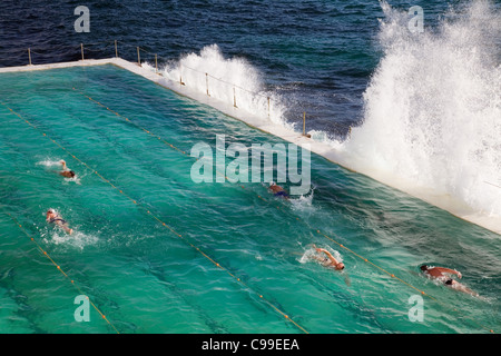 Swimmers doing laps at the Bondi Baths - home to the Bondi Icebergs swimming club. Sydney, New South Wales, Australia - Stock Photo