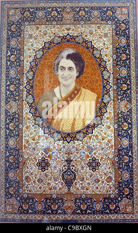 Indira Gandhi portrait on a textile carpet , late Indian prime minister - Stock Photo
