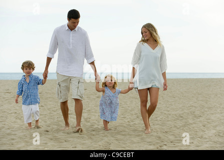 Family walking hand in hand at the beach - Stock Photo