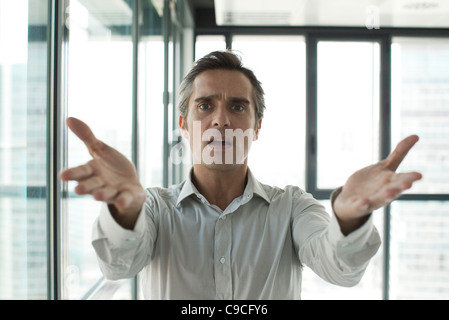 Man throwing up hands in frustration - Stock Photo