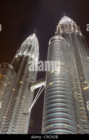 Petronas twin towers in Kuala Lumpur at night time. - Stock Photo