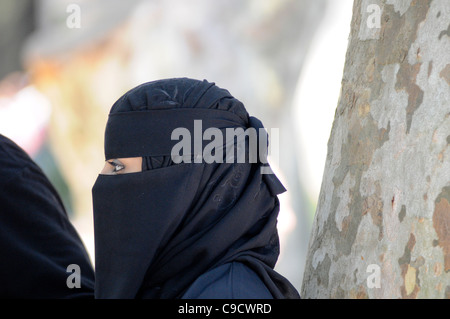 Muslim woman wearing black burka. Istanbul, Turkey - Stock Photo