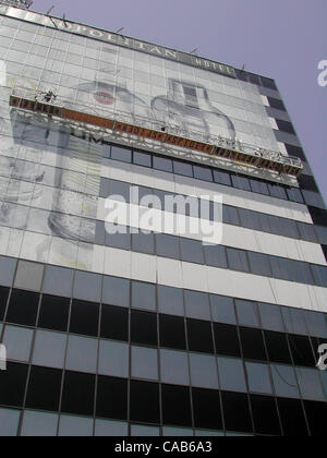 May 08, 2004; Los Angeles, CA, USA; Workers put the finishing touches on a Barcardi advertisement on the side of - Stock Photo