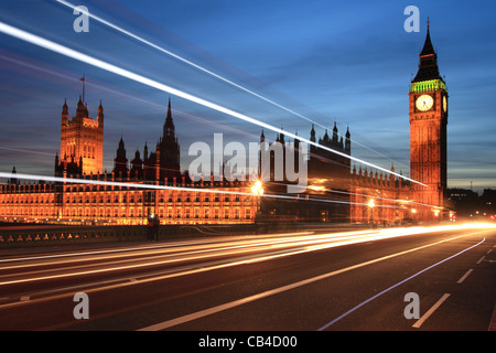Westminster Bridge, traffic trails, Big Ben and the Houses of Parliament, London, England, UK - Stock Photo