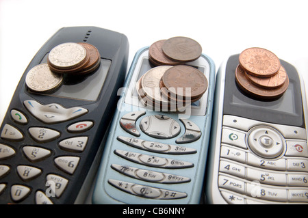 Three mobile phones with money - Stock Photo
