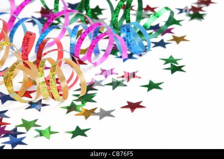 Colorful streamers and confetti on a white background - Stock Photo