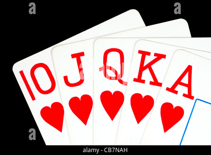 royal flush poker hand playing cards - 10, Jack, Queen, King, Ace of hearts - Stock Photo