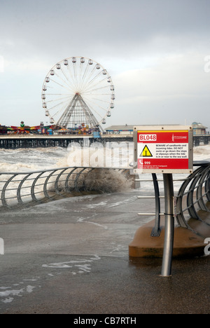 Danger Blackpool seafront signage Take Care and Beware - Stock Photo