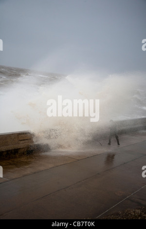 'Fishing in a Storm'  Stormy Seas and receding waves during the High tide at Blackpool, Lancashire, UK - Stock Photo