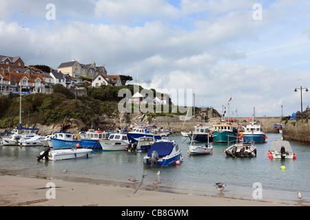 Newquay, Cornwall, England, UK, Britain. View from the beach to fishing boats moored in the harbour - Stock Photo