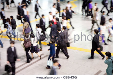 overhead view of commuters during rush hour Tokyo Japan - Stock Photo