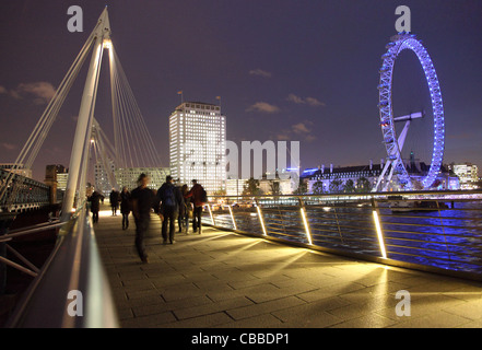 Night time view of London's South Bank showing Hungerford Footbridge, the Shell Centre, the River Thames and the - Stock Photo