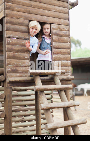 Children playing in playhouse - Stock Photo