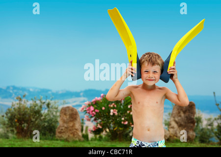 Boy playing with fins outdoors - Stock Photo