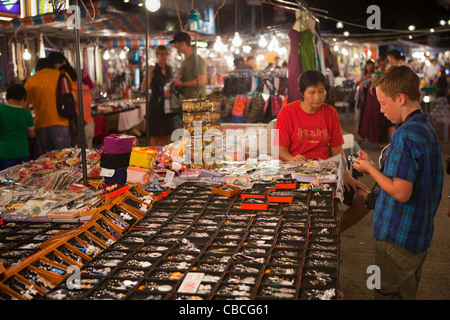 Young Boy shopping at Temple Street Night Market, Hong Kong. - Stock Photo