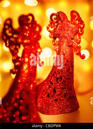 Red angel Christmas tree ornament, holiday background with bokeh lights and decoration - Stock Photo