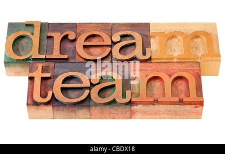 teamwork concept - dream team words in vintage wooden letterpress printing blocks, stained by color inks, isolated - Stock Photo